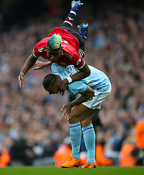 Manchester United's Paul Pogba (left) and Manchester City's Danilo battle for the ball during the Premier League match at the Etihad Stadium, Manchester.