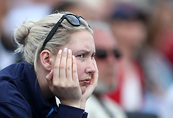 A fan watches the action during day five of the 2017 AEGON Championships at The Queen's Club, London.