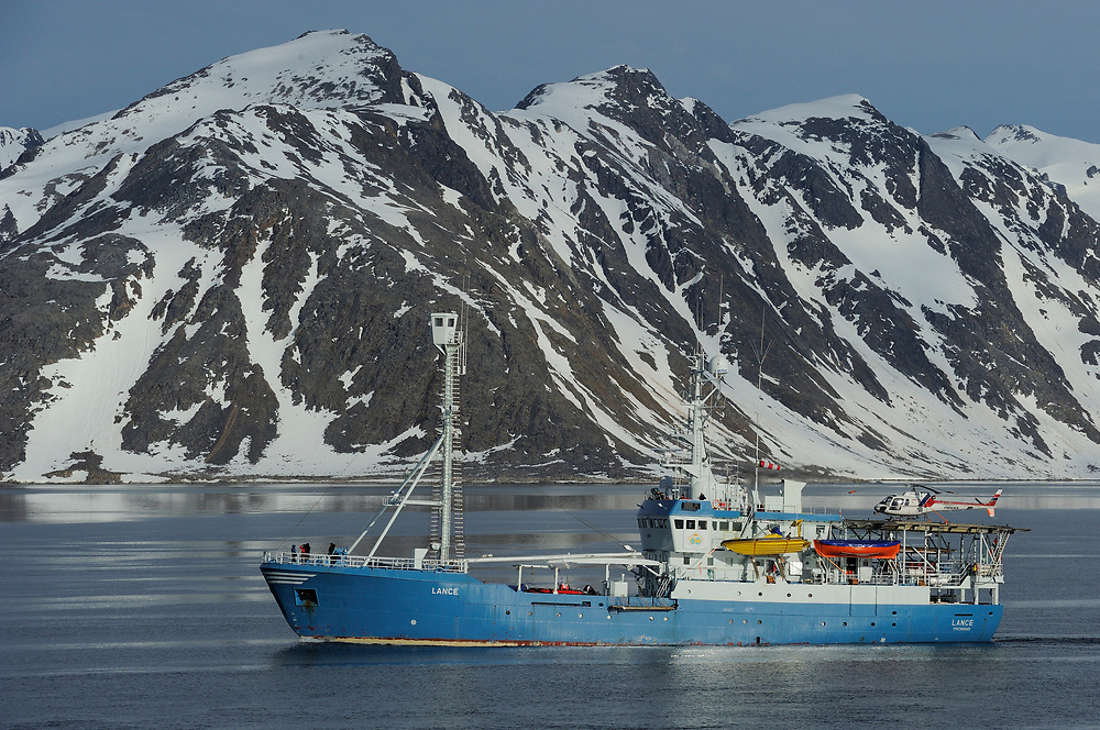 Ship in Arctic mountain landscape, Svalbard, Norway