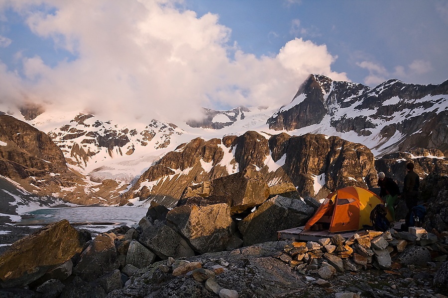 Sunset light strikes a tent pitched at the scenic campsite besides Wedgemount Lake in Garibaldi Provincial Park, British Columbia, Canada on June 13, 2009.