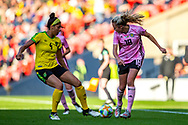 Claire Emslie (#18) of Scotland backheels the ball under pressure from Chantelle Swaby (#4) of Jamaica during the International Friendly match between Scotland Women and Jamaica Women at Hampden Park, Glasgow, United Kingdom on 28 May 2019.