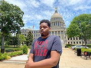 """Today at the Mississippi State Capitol 29 yr old history teacher from Cardozo Middle School ,Dhahran Hall, spoke truth to power and lead  demonstrators in support of Black Lives Matter and against the brutal  murder of George Floyd and police brutality and systematic racism. Protestors gathered at the State Capitol and marched around downtown Jackson returning to the Capitol they chanted """" Say There Names"""", """" I can't Breathe"""", """" No Justice No Peace"""" """" Justice for George Floyd"""" it was a very peaceful protest and march.  In the past 6 days protests and riots have broken out across America in response to the brutal killing of an unarmed African American man by the knee and hands of Minnesota Police<br /> Officers. Photo copyright © @suzialtman #Suzi Altman #protest#peace #blacklivesmatter #georgefloyd #policebrutality #racism #america #mississippi #peacefulprotest #teachlovenothate, white supremacy, cover-19, corona virus, pandemic"""