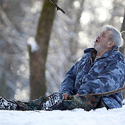 German wolf researcher Werner Freund, 79, howls in an enclosure for Arctic wolves at the wolves park in Merzig in the German province of Saarland January 24, 2013. Freund established a home for wolves in 1972 and raised more than 70 animals in the last 30 years. Freund had to become a wolf among wolves to be accepted by the pack. Picture taken January 24, 2013.  REUTERS/Lisi Niesner  (GERMANY)