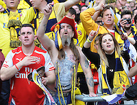 Arsenal fans in action during todays match  <br /> <br /> Photographer Ashley Crowden/CameraSport<br /> <br /> Football - The FA Cup Final - Aston Villa v Arsenal - Saturday 30th May 2015 - Wembley - London<br /> <br /> © CameraSport - 43 Linden Ave. Countesthorpe. Leicester. England. LE8 5PG - Tel: +44 (0) 116 277 4147 - admin@camerasport.com - www.camerasport.com