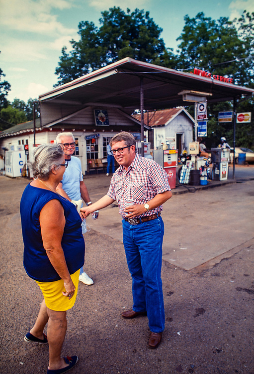 """Billy Carter meets tourists in front of his Plains, Georgia gas station. William Alton - Billy - Carter (March 29, 1937 – September 25, 1988) was an American farmer, businessman, brewer, and politician, and the younger brother of U.S. President Jimmy Carter. Carter promoted Billy Beer and was a candidate for mayor of Plains, Georgia. Carter was born in Plains, Georgia, to James Earl Carter Sr. and Lillian Gordy Carter. He was named after his paternal grandfather and great-grandfather, William Carter Sr. and William Archibald Carter Jr. respectively. He attended Emory University in Atlanta but did not complete a degree. He served four years in the United States Marine Corps, then returned to Plains to work with his brother in the family business of growing peanuts. In 1955, at the age of 18, he married Sybil Spires (b. 1939), also of Plains. They were the parents of six children: Kim, Jana, William """"Buddy"""" Carter IV, Marle, Mandy, and Earl, who was 12 years old when his father died."""