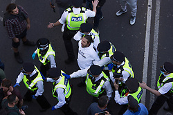 © Licensed to London News Pictures.  24/04/2021. London, UK. A protester is detained as anti-vaccination and anti-lockdown protesters take part in central London. Photo credit: Marcin Nowak/LNP