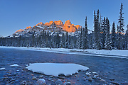 Castle Mountain and the Bow River at sunset. Castle Junction, Banff National Park, Alberta, Canada