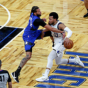 ORLANDO, FL - MARCH 01: Michael Carter-Williams #7 of the Orlando Magic fouls Jalen Brunson #13 of the Dallas Mavericks during the second half at Amway Center on March 1, 2021 in Orlando, Florida. NOTE TO USER: User expressly acknowledges and agrees that, by downloading and or using this photograph, User is consenting to the terms and conditions of the Getty Images License Agreement. (Photo by Alex Menendez/Getty Images)*** Local Caption *** Michael Carter-Williams; Jalen Brunson