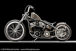 """'California Kid"", silver and gray rigid chopper, built from a 1984 Shovelhead, by Peter Ballard, in  Barrington, NH.  Photographed by Michael Lichter in Sturgis, SD on 8/1/18. ©2018 Michael Lichter."
