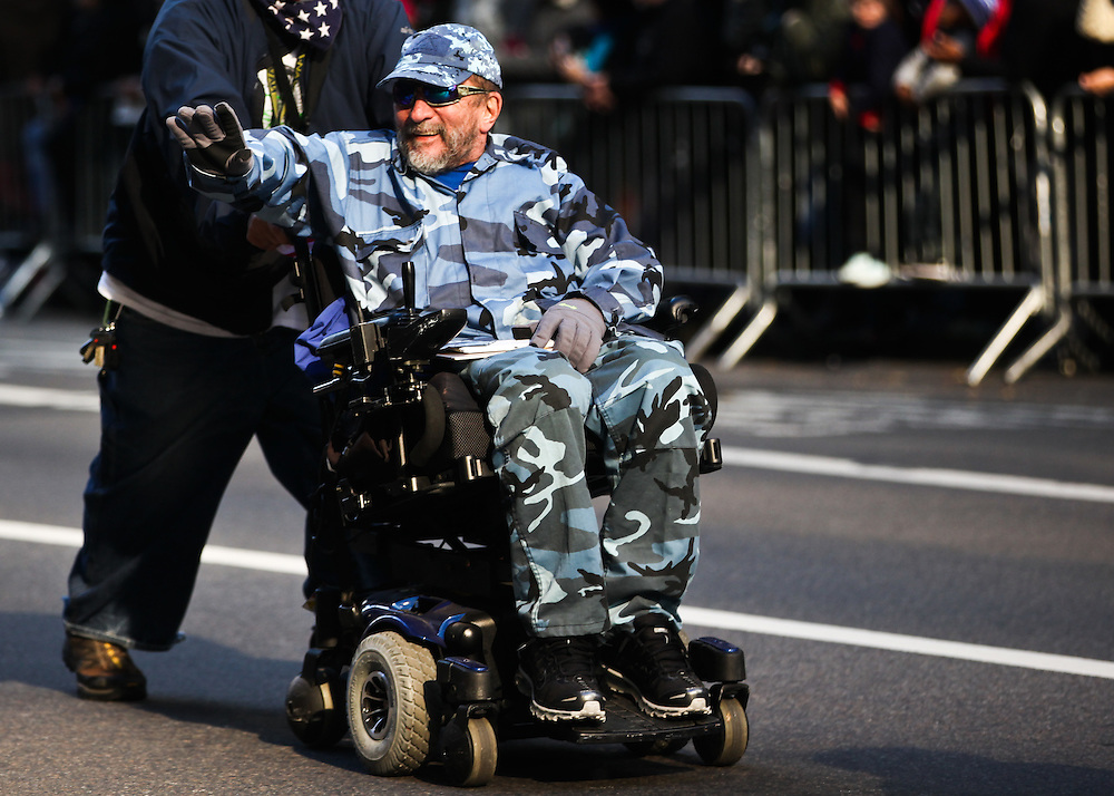 U.S. Air Force Vietnam veteran Richard Nowakoski, 65, of Northport, makes his way up 5th Avenue as members and supporters of the U.S. Armed services came to celebrate their sacrifices during the Veterans Day Parade in Manhattan on Friday, November 11, 2016. (Credit: Byron Smith)