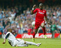 Photo: Chris Ratcliffe.<br />Liverpool v West Ham United. The FA Cup Final. 13/05/2006.<br />Danny Gabbidon (L) of West Ham tussles with Djibril Cisse of Liverpool.
