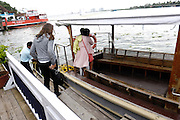 Thursday 14th August 2014: Tourists board a boat at the Brunton Boathouse Hotel.