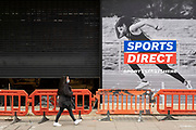 People out and about pass the closed shuttered Sports Direct on Oxford Street on 25th May 2021 in London, United Kingdom. As the coronavirus lockdown continues its process of easing restrictions, more and more people are coming to the West End as more businesses open.