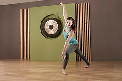 Woman fitness studio dance exercise posing