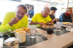 Bob Zeolla (L) and Greg Allen (Hagerty Insurance) enjoying their Waffle House lunch stop during the Cross Country Chase motorcycle endurance run from Sault Sainte Marie, MI to Key West, FL. (for vintage bikes from 1930-1948). Stage-7 covered 249 miles from Macon, GA to Tallahassee, FL USA. Thursday, September 12, 2019. Photography ©2019 Michael Lichter.