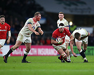 Aaron Shingler of Wales © slips with the ball as England's Dylan Hartley (l) and Owen Farrell ® close in. England v Wales, NatWest 6 nations 2018 championship match at Twickenham Stadium in Middlesex, England on Saturday 10th February 2018.<br /> pic by Andrew Orchard, Andrew Orchard sports photography
