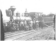 """RGS 2-8-0 #13 posing with Ridgway roundhouse crew.<br /> RGS  Ridgway, CO  Taken by Wolfinger, Clemente D. - 1898<br /> In book """"RGS Story, The Vol I: Over the Bridges-Ridgway to Telluride"""" page 55<br /> Also in """"RGS Story Vol. XI"""", pp. 28-29; """"Silver San Juan"""", p. 106 and """"Narrow Gauge Country"""", p. 105."""