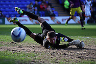 Notts County's goalkeeper Bartosz Bialkowski watches as the ball goes just wide of his goal. Skybet football league one match, Tranmere Rovers v Notts county at Prenton Park in Birkenhead, England on Saturday 15th March 2014.<br /> pic by Chris Stading, Andrew Orchard sports photography.