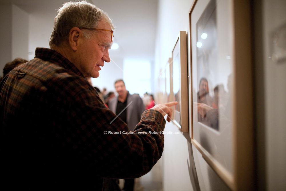 """David Letterman at his staff's holiday party and photo gallery exhibition by his staff writer Steve Young entitled """"CELEBRIGUM"""" held at Ameringer McEnery Yohe Gallery  in New York. ..Photo by Robert Caplin."""