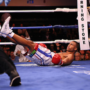 Thomas Dulorme gets knocked down by Luis Carlos Abregu during their fight for the WBC International title during the HBO Triple Explosion fight at the Turning Stone Resort Casino in Verona, NY, on Saturday, Oct 27, 2012.  Abregu won the bout by TKO in the 7th round.(AP Photo/Alex Menendez)
