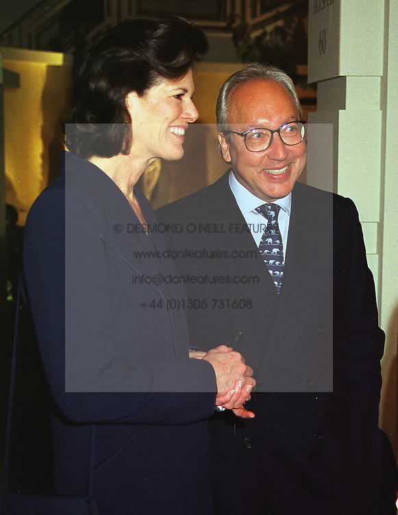 MR & MRS URS SCHWARZENBACH, he is the swiss multi millionaire polo patron, at an antiques fair in London on 9th June 1999.MSY 105