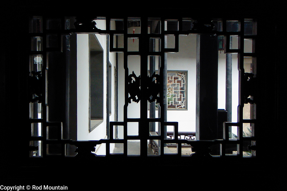 From an old building, looking to the outside, a silhouette is created. China.