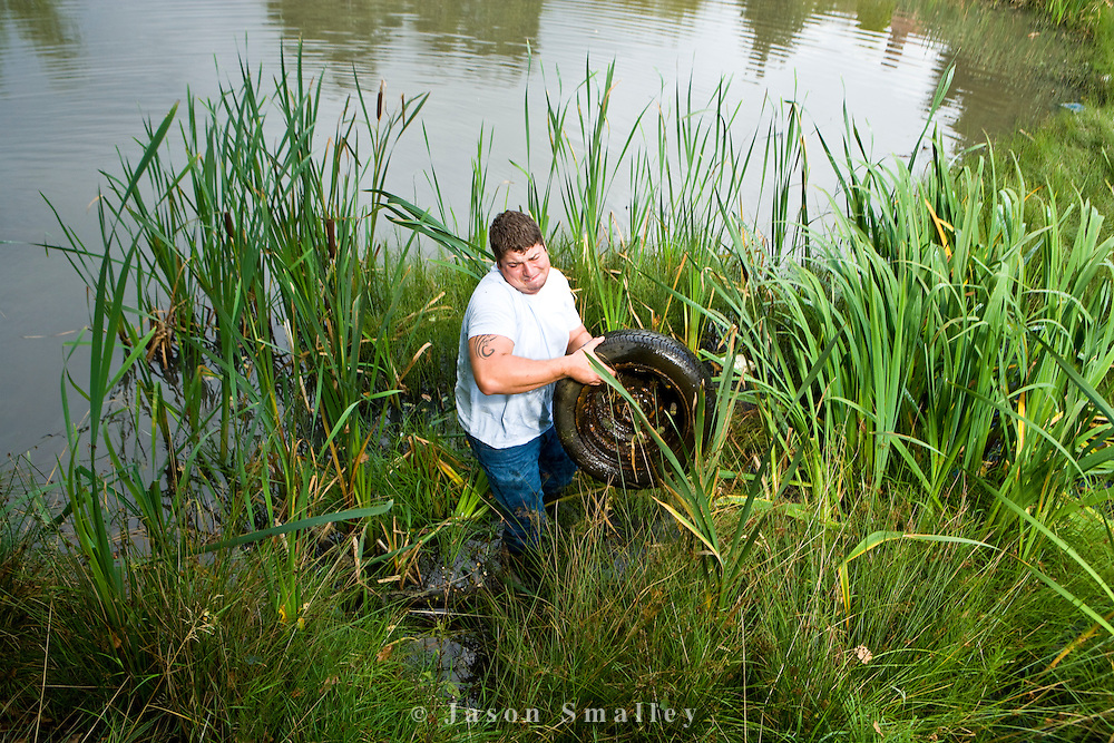 removing rubbish, a tyre from a pond