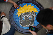 XI'AN, CHINA - APRIL 3: (CHINA OUT) <br /> <br /> Manhole Cover Paintings <br /> <br /> A student cleans the cartoon pattern painted on the manhole cover at the Northwestern Polytechnical University on April 3, 2014, in Xi'an, Shaanxi Province of China. The activity was held by the Youth League of the university which aimed at drawing people's attention to protect the manholes. It was reported that a girl in Changsha of Hunan Province of China fell into the sewer and dead due to the missing of a manhole cover. There are more than 600 manhole covers in the campus and they will paint the 198 of them in a few weeks.<br /> ©Exclusivepix