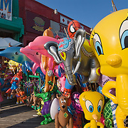 Brooklyn, NY - Inflatable toys outside a store at the Coney Island boardwalk. Located in south Brooklyn, Coney Island is the site of a public beach, boardwalk and amusement park. Prior to the 1950's, it was the largest amusement area in the US, attracting several million visitors per year.
