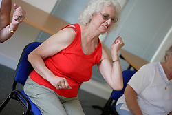 Older woman taking part in keep fit class,