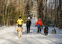 """Sebastian"", ""Jake"" and ""Trapper"" eagerly lead the way for Jan Jeffrey, Lisa Keller and Carolyn Larocque as they head out for their weekly walks at Ahern State Park on Saturday.  (Karen Bobotas/for the Laconia Daily Sun)"