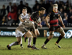Dragons' Zane Kirchner is tackled by Glasgow Warriors' James Malcolm<br /> <br /> Photographer Simon King/Replay Images<br /> <br /> Guinness PRO14 Round 14 - Dragons v Glasgow Warriors - Friday 9th February 2018 - Rodney Parade - Newport<br /> <br /> World Copyright © Replay Images . All rights reserved. info@replayimages.co.uk - http://replayimages.co.uk