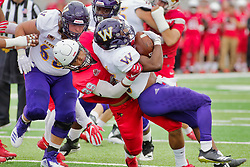 NORMAL, IL - October 06:  Zachary Mathews tackles Steve McShane during a college football game between the ISU (Illinois State University) Redbirds and the Western Illinois Leathernecks on October 06 2018 at Hancock Stadium in Normal, IL. (Photo by Alan Look)