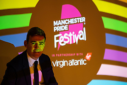 © Licensed to London News Pictures . 27/08/2021. Manchester, UK. Metro Mayor of Greater Manchester ANDY BURNHAM poses for a photo at a Manchester Pride launch party at Whitworth Locke in Manchester City Centre . The Pride event was cancelled in 2020 due to Coronavirus . Manchester Pride charity has been criticised after it withdrew funding for the LGBT Foundation's condom distribution scheme and withdrew support for HIV charity George House Trust over GHT's support for HIV positive people of all sexualities . Manchester Pride chief executive Mark Fletcher has received a £20,000 pay rise over the last two years and now earns between £90,000 and £100,000 . Photo credit: Joel Goodman/LNP
