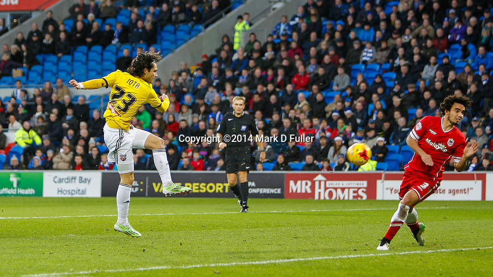 Brentford FC's Jota takes a shot during the Sky Bet Championship match between Cardiff City and Brentford at the Cardiff City Stadium 20/12/2014<br /> Picture by Mark D Fuller