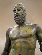 Upper torso of the Riace bronze Greek statue B cast about 460 - 450 BC. statue B was probably sculpted by Phidias. There is a sense of movement in the statues their legs being bent as if they are about to take a step. Their heads are turned which accentuates a sense of anticipation as if they are looking for something. The anatomical detail is extraordinary which gives a startling realism to the statue and demonstarte the high level of skill of the Greek sculptors of this peiod. Museo Nazionale della Magna Grecia,  Reggio Calabria, Italy.  .<br /> <br /> If you prefer to buy from our ALAMY STOCK LIBRARY page at https://www.alamy.com/portfolio/paul-williams-funkystock/greco-roman-sculptures.html . Type -    Riace     - into LOWER SEARCH WITHIN GALLERY box - Refine search by adding a background colour,  etc.<br /> <br /> Visit our ROMAN WORLD PHOTO COLLECTIONS for more photos to download or buy as wall art prints https://funkystock.photoshelter.com/gallery-collection/The-Romans-Art-Artefacts-Antiquities-Historic-Sites-Pictures-Images/C0000r2uLJJo9_s0
