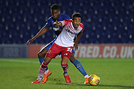 AFC Wimbledon defender Paul Kalambayi (30) battles for possession with Stevanage attacker Kurtis Guthrie (28) during the EFL Trophy group stage match between AFC Wimbledon and Stevenage at the Cherry Red Records Stadium, Kingston, England on 6 November 2018.