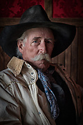 Cowboys & Cowgirls Gallery<br /> <br /> This man is a life-long working cowboy. He's the real deal and reveals his years of experience through his actions, deeds and fascinating stories. The details of his life are left to the viewer's imagination.