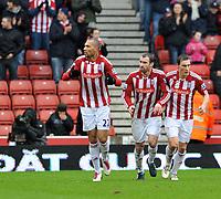 Stoke City/Sunderland Premiership 05.02.11<br />Photo: Tim Parker Fotosports International<br />John Carew Stoke City celebrates his 1st goal for the club with Danny Higginbotham and Dean Whitehead
