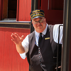 Strasburg, PA, USA - June 20, 2017:  A train conductor waves at the station in Strasburg, Lancaster County.