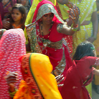 Asia, India, Rajasthan. Women dancing in colorful saris.