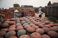 Workers organize ceramic bowls in the pottery village of Phu Lang, Que Vo District, Bac Ninh Province, Hanoi, Vietnam, Southeast Asia