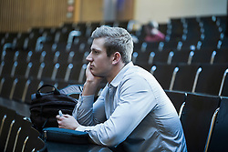 College student sitting in lecture hall and listening lecture, Freiburg im Breisgau, Baden-Wuerttemberg, Germany