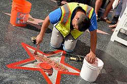 A man defaced Republican presidential candidate Donald Trump's star on the Hollywood Walk of Fame Wednesday, hacking out the gold lettering displaying his name and the television logo. The vandalized Star is being repaired and cleaned up on October 26, 2016 in Los Angeles, California. Photo by Lionel Hahn/AbacaUsa.com