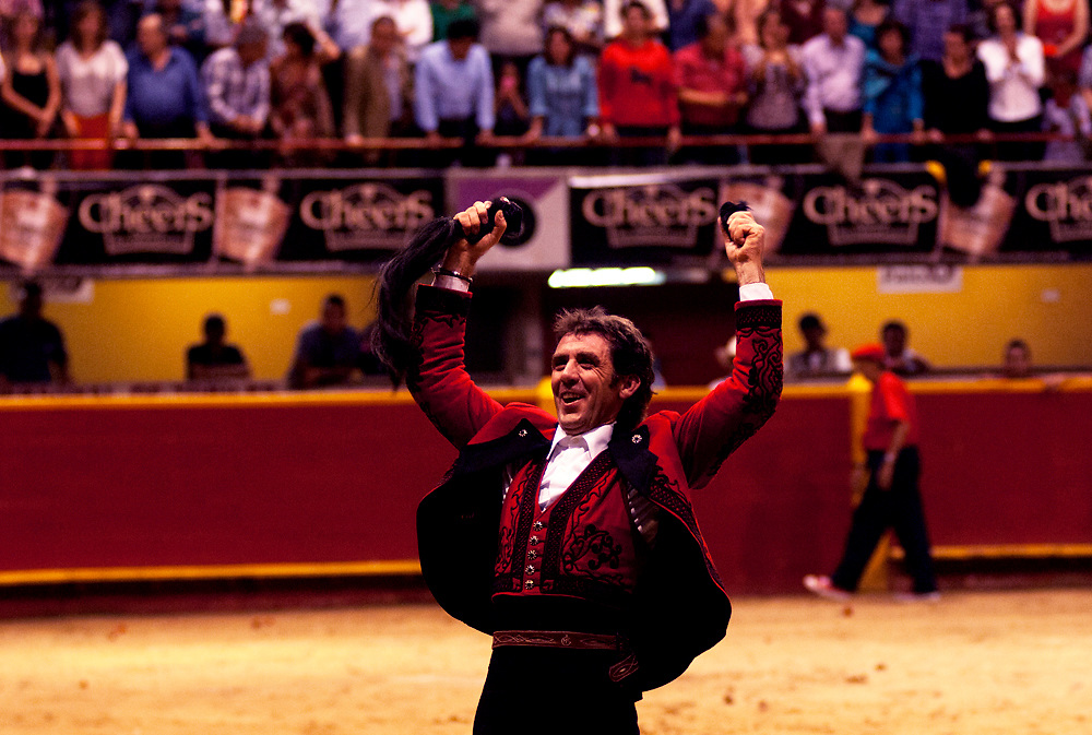 In the ring at La Macarena, a picadore holds the tail and ear of the bull he just fought.  The cutting of the ear and tail is done in respect to the dignitaries attending the event.  Colombia is one of the few Latin American countries where the original form of bullfighting is still practiced.
