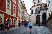 """Mostly Czech visitors are moving through empty """"Karlova street"""" which leads from Old-Town Square towards Charles Bridge and the Lesser Town (Mala Strana). The street belongs to the Royal Route which is normally one of the most frequented by tourist and now almost empty. The Czech government lowered the security measures and as of Monday 25 May 2020, wearing of protective masks will be mandatory only in the interiors of buildings other than the place of residence and in public transport."""