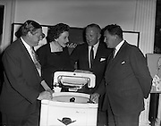 29/09/1960<br /> 09/29/1960<br /> 29 September 1960<br /> Servis Washing Machines Reception. Reception by Servis Washing Machines and G.E.C. held at the Shelbourne Hotel, Dublin to introduce new range of machines. Picture shows (l-r): Edward Wilkins, Managing Director, Messrs Wilkins and Mitchel Ltd., Darlaston, Staffordshire; Mary Collins; Martin F. McCourt, Managing Director G.E.C. Dunleer and G.L. Hay, Director Cork Iron and Hardware, Co. Cork, examining one of the new machines.