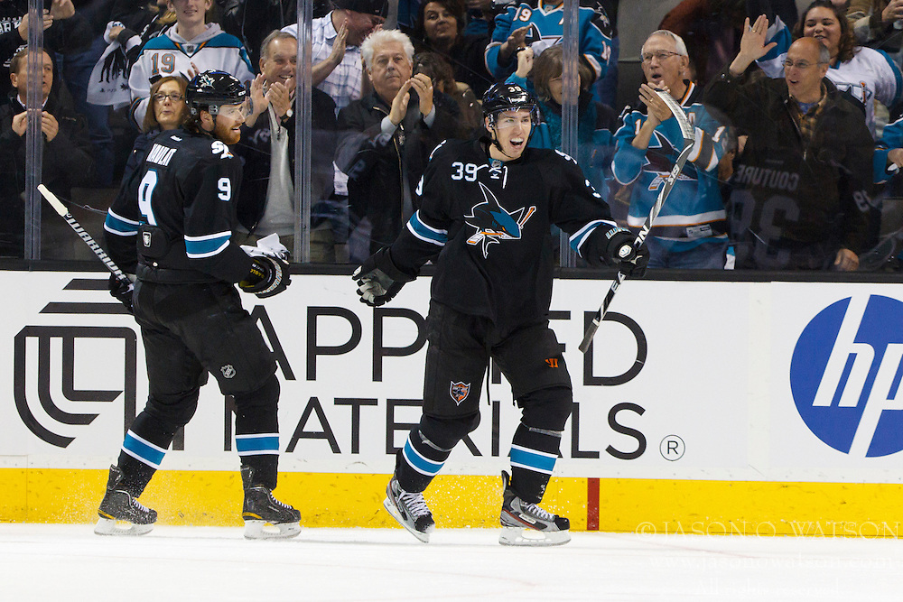 Dec 1, 2011; San Jose, CA, USA; San Jose Sharks center Logan Couture (39) celebrates after scoring a goal against the Montreal Canadiens during the second period at HP Pavilion.  Mandatory Credit: Jason O. Watson-US PRESSWIRE