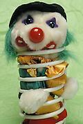 Stuffed toy clown in coil