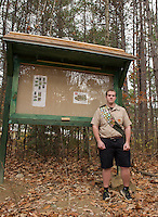 Thomas Hayes stands at the trail kiosk he built as part of his Eagle Scout project at the Jeff Marden Forest in Belmont.  (Karen Bobotas/for the Laconia Daily Sun)
